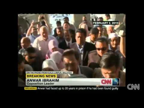 Latest - Malaysian court finds opposition leader Anwar not guilty of sodomy - CNN.com.mp4