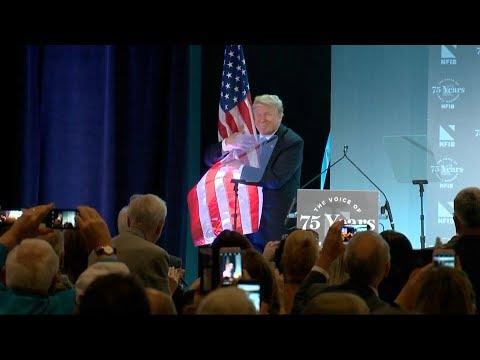 Trump hugs American flag after immigration speech