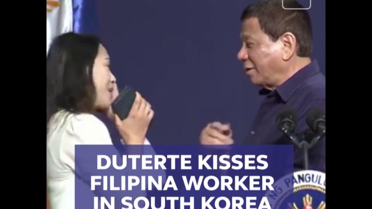 Duterte kisses Filipina worker in S. Korea