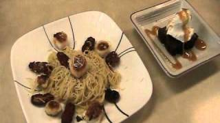 Fresh Scallops And Garlic With Sundried Tomatoes Over Angel Hair Pasta