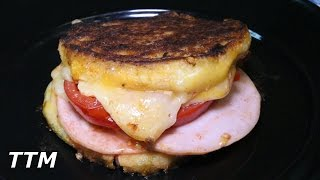 Grilled Cheese Sandwich with Canadian Bacon and Tomato on the Stovetop Cast Iron Griddle