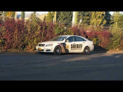 cop watchers put sign at Washington county jail