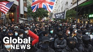 Hong Kong protesters take part in rally as government urges calm