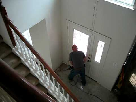 Removing old ceramic tile from foyer - YouTube