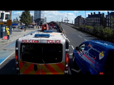 Police Van 'Toys' With Cheeky Queue Jumper