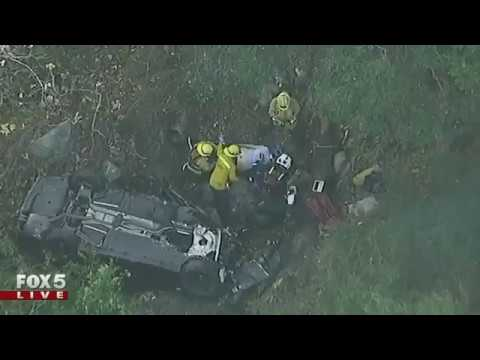 Rescue workers pull driver from which ran off cliff in Malibu