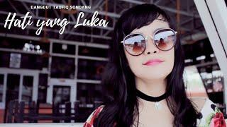 Download lagu lagu Dangdut populer HATI YANG LUKA taufiq sondang