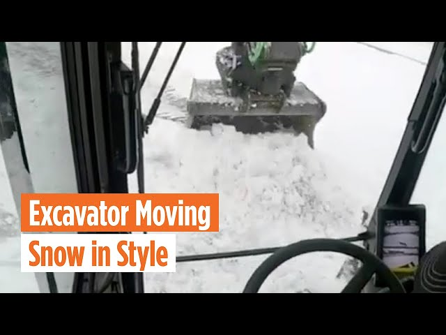 Excavator Moving Snow in Style