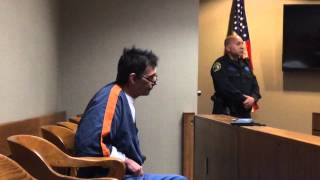 Man charged with child porn scoffs during his arraignment in Flint