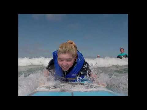 Surfing Dog Surfs with sisters who have terminal illness.