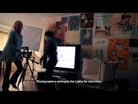 MICA interviews Carlos Florez. Phoographers setting Up theLights for interview
