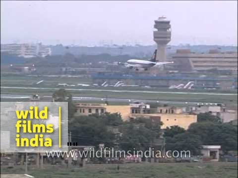 Jet Airways plane landing on runway at Indira Gandhi International Airport, Delhi
