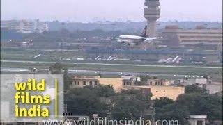 Jet Airways plane landing on a runway at Indira Gandhi International Airport, Delhi