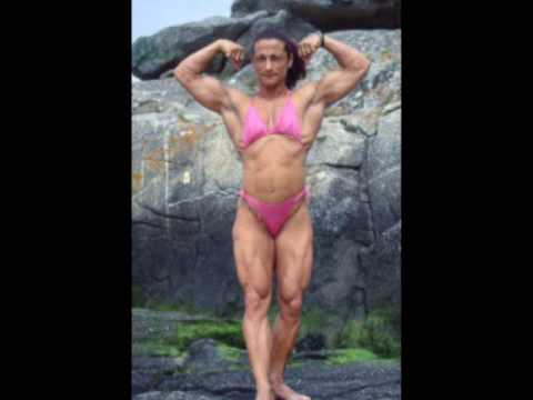 Incredible muscle girl rides dildo and flexes biceps 2