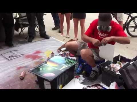 Travis Knapp the spray painter street artist on State St., Madison, WI