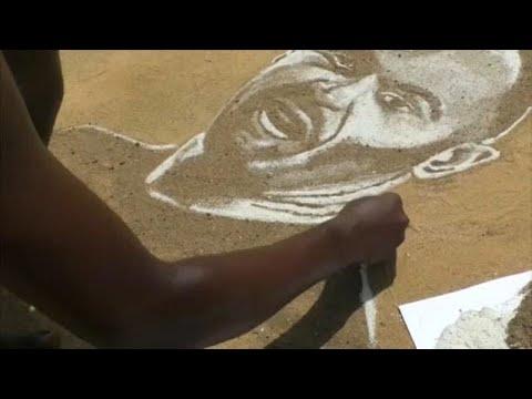 شاهد: فنان كاميروني يرسم أساطير كرة القدم بالرمال  - 22:00-2020 / 5 / 19
