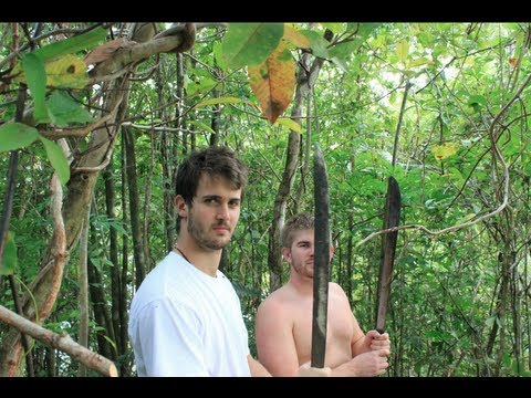 Using Machetes to clear a path to the top of the island!