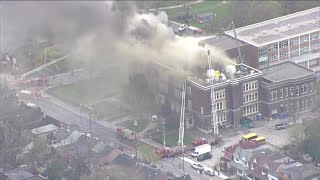 Crews battle 4-alarm roofing blaze at adult learning centre in Greektown
