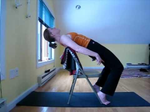 yoga pose urdhva dhanurasana / wheel  chair as prop