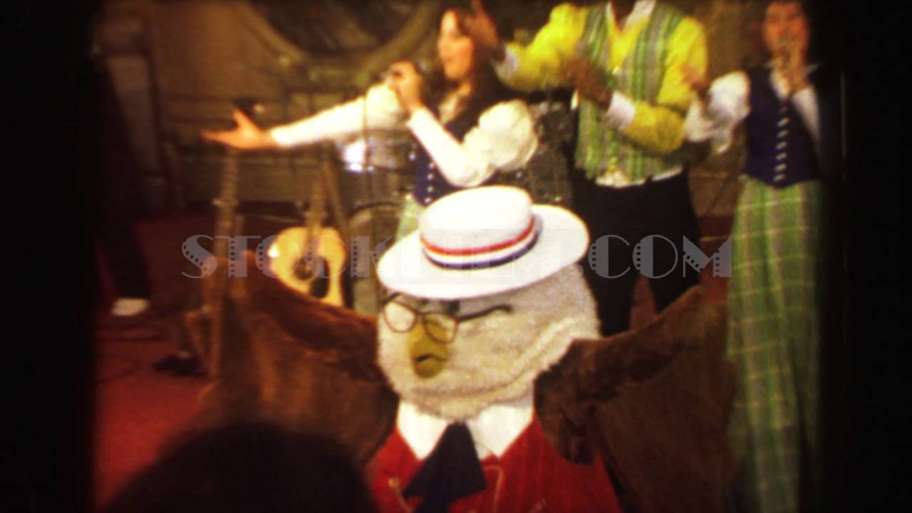 1970: Busch Gardens mascot leading singing performance group ending ...