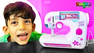 Jason Plays with Toy Sewing Machine