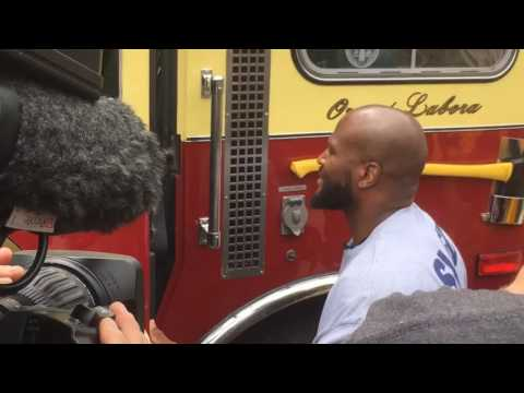 James Harrison drives a fire truck at Steelers training camp