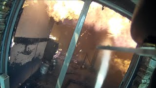 Firefighter helmet cam at a structure fire fully involved.