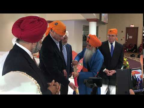Gov. Charlie Baker receiving a ceremonial sword, a gift from the New England Sikh Study Circle