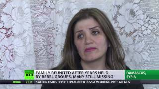 'Caged by war'  Captives held for years by Syrian rebels reunite with families