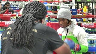 Undefeated Jamie Mitchell padwork with trainer Dewey Cooper inside the Mayweather Boxing Club