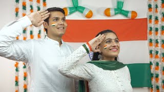 Indian teens saluting Indian flag looking up in the sky - Independence Day
