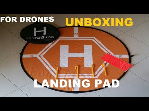 Unboxing landing pad for drones
