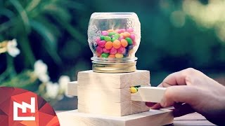 This is a candy dispenser made with wood and a mason jar. Perfect for skittles and small sweet candies, children love it ! This is a