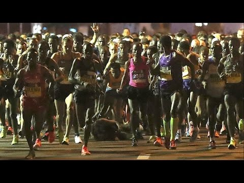 Kenenisa Bekele falls at the start of the 2017 Dubai Marathon