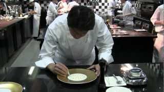 Danzaki prepares a signature dish at Joël Robuchon in Singapore
