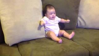 Baby Launa listening to baby vuvu