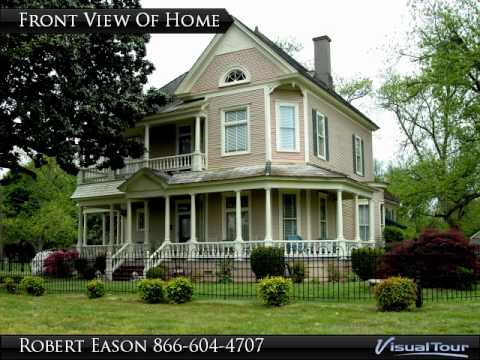 3,921 sq ft Queen Anne style home for sale on 11.3 manicured acres in Holly Grove, Arkansas