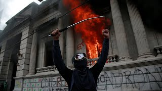Guatemalans set fire to Congress in furious protest against government