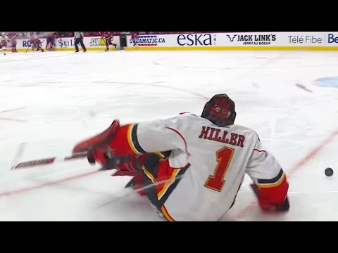 Hiller wipes out trying to play the puck
