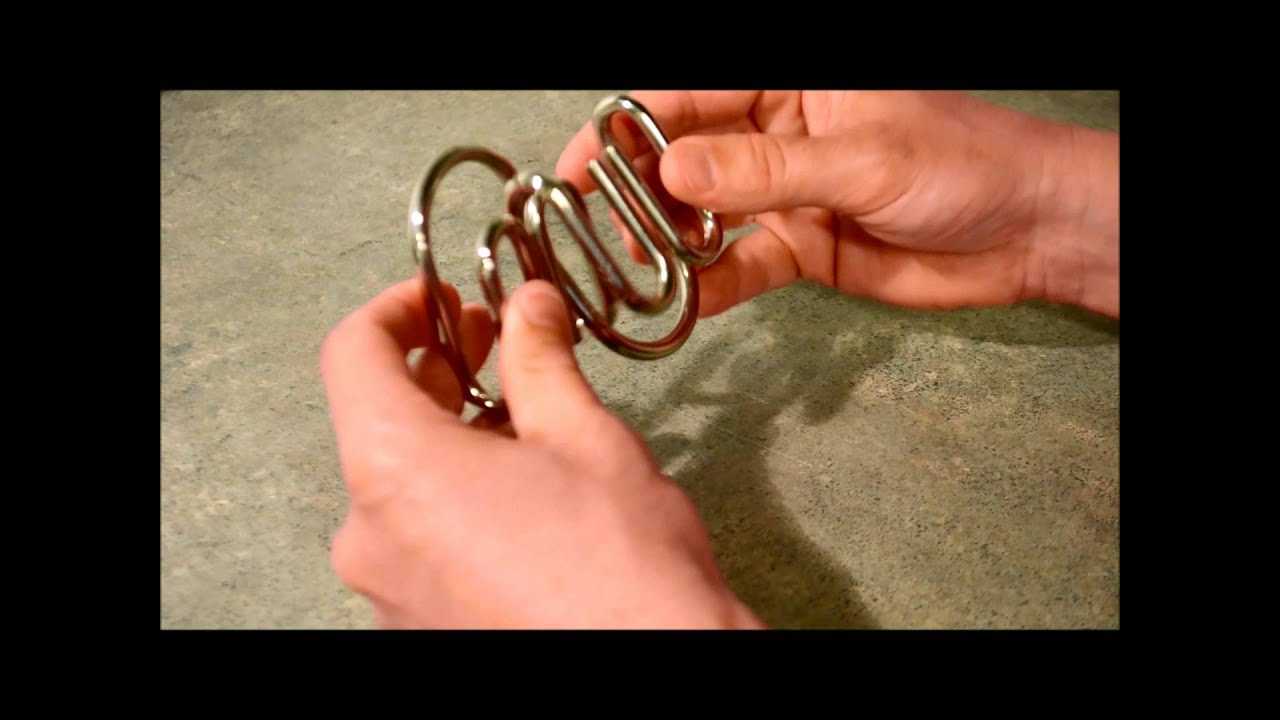 Solving Metal Ring Puzzles