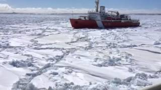 mv highlander got stuck in the ice monday night and a coast guard ship arrives to help