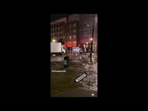 Guy Tries To Carry Girlfriend Across Flood But Fails, Another Man Steps In To Save Her