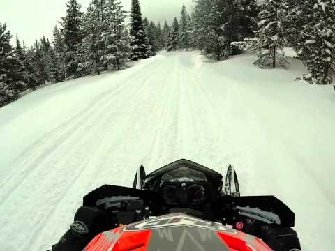 Snowmobile Ride into West Yellowstone, MT from Two Top Loop Trail