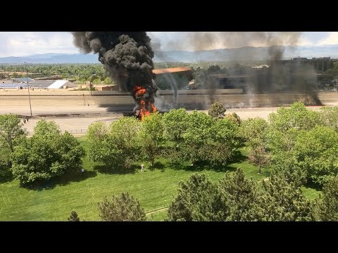 RAW: Bystander films man jumping from fuel tanker as it explodes into flames