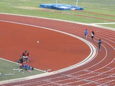Naihya (white tights) 1500m Texas Torch meet 4.15.17 2nd in heat 1st in age group13-14