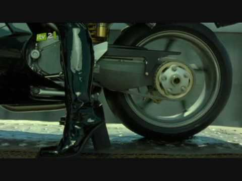 CarrieAnne Moss aka Trinity on ducati 996 motorbike