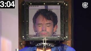 Locked up escape artist holds his breath for 7 minutes underwater!