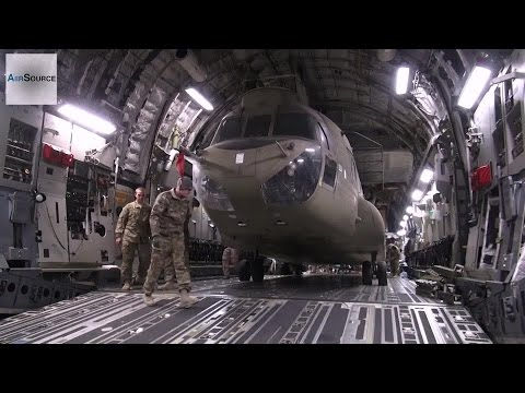 Loading CH-47F Chinook Helicopter Into C-7 Aircraft