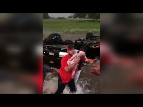 Thumbnail: Strangers Save Father and 2 Babies Trapped Inside Overturned Truck During Floods