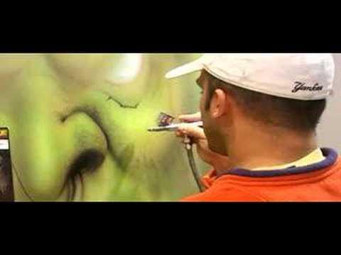 Steve Nunez airbrushes a